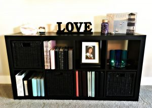 Black Shelf with Mellow Beach Decor after Spring Re-Style