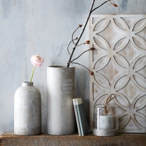 5 Key Items to create your perfectly styled shelf. This cement vase is available at Pottery Barn.com. What makes a shelf have that interior decorator feel, do you ever wonder why some shelves really make you stop and take a look while others are basically flying under the radar? Follow this list with the 5 key items your shelf must have for a perfectly styled look.